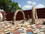 Sculpture of a snake inside Rock Garden, made of Concrete and Tile pieces